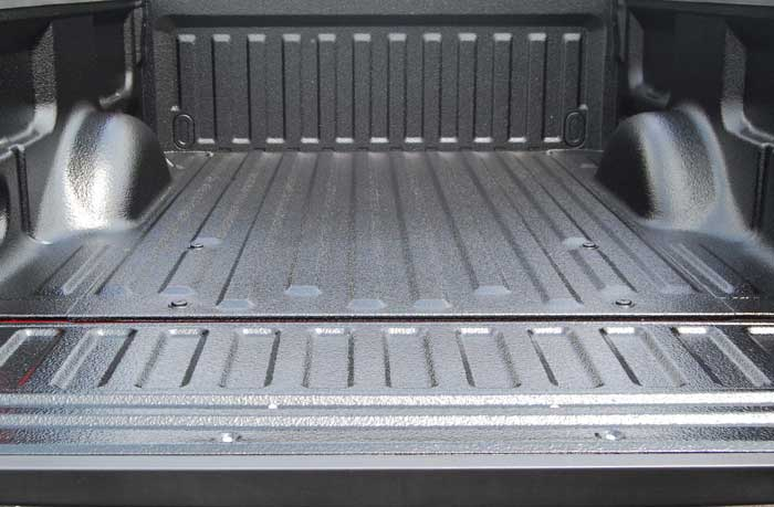 Spraying Bottom Of Truck With Truck Bed Liner